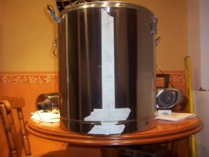mash tun with masking tape on side