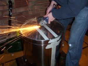 grinding skin from mash tun base with angle grinder 1