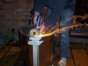 grinding skin from mash tun base with angle grinder 2