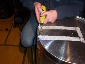 removing skin from mash tun base with dremmel